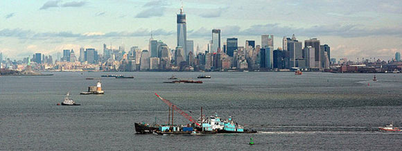 John B. Caddell with tug and crane barge assist on her way to repair yard.  Photo: Staten Island Advance