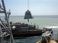 Stack of USS Guardian hoisted by crane ship. Photo:PCG