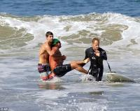 Attack victim being carried through surf